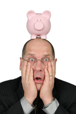 Business Man with Piggy Bank on head and hands on face